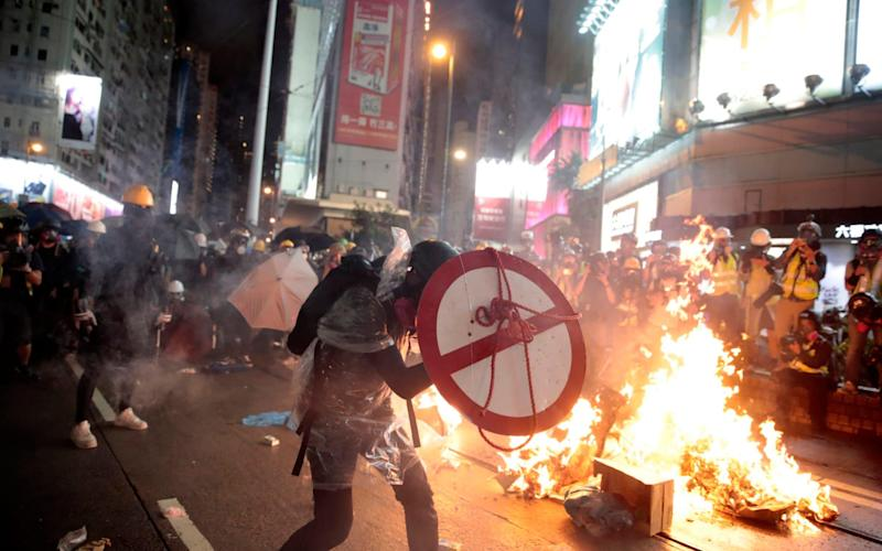 China is seeking to impose draconian new security laws in Hong Kong - AP