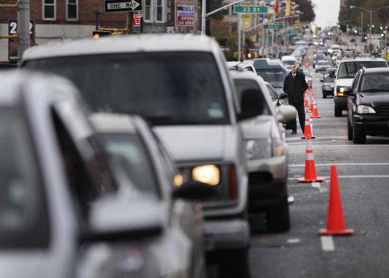 FILE- In this Nov. 2, 2012 file photo, cars wait in a 30 block long line for gas in the Brooklyn borough of New York. New York Mayor Michael Bloomberg and officials in the Long Island counties of Nassau and Suffolk have decided to start an even-odd gas rationing plan beginning at 5 a.m. Friday, Nov. 9, 2012. (AP Photo/Seth Wenig, File)