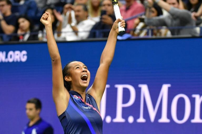 Canada's Leylah Fernandez celebrates after defeating defending champion Naomi Osaka in the third round of the US Open (AFP/Ed JONES)