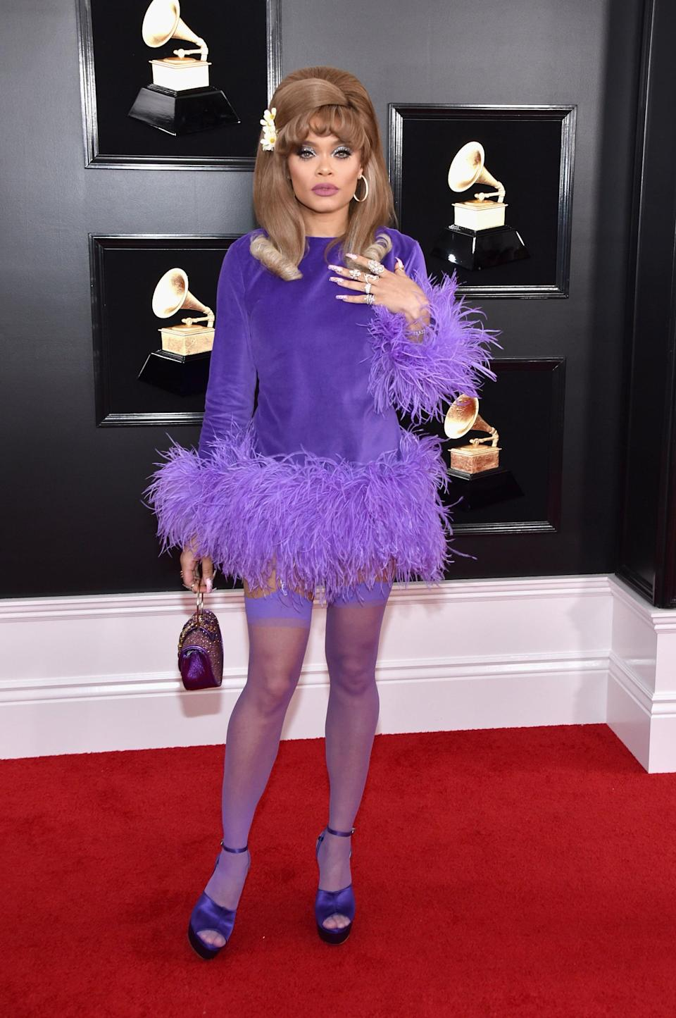 <p>Wearing a purple feathered minidress and Sophia Webster heels.</p>