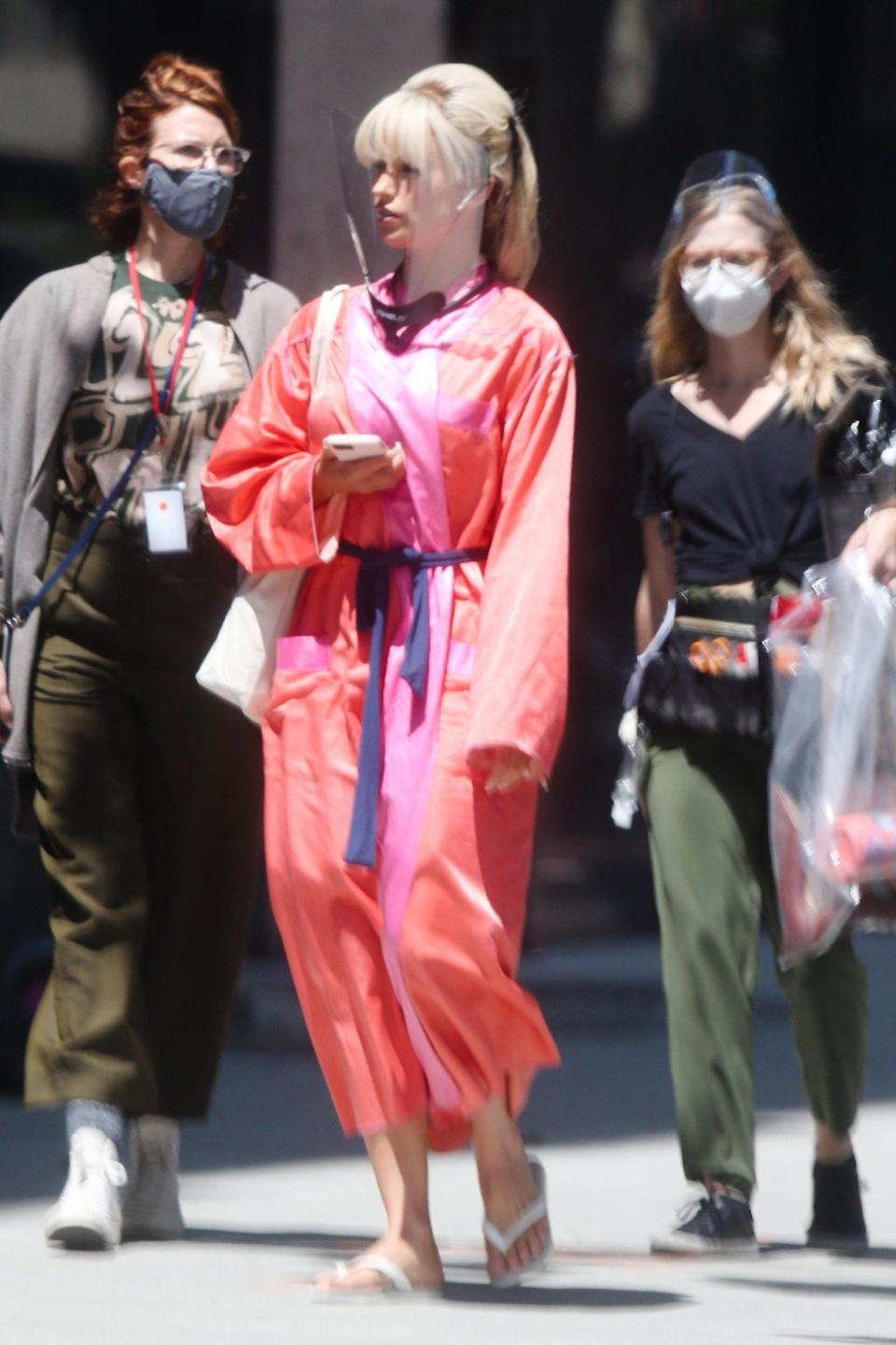 <p>Lily James gets into character as Pamela Anderson on the set of Hulu's <em>Pam & Tommy</em> on Monday in L.A.</p>