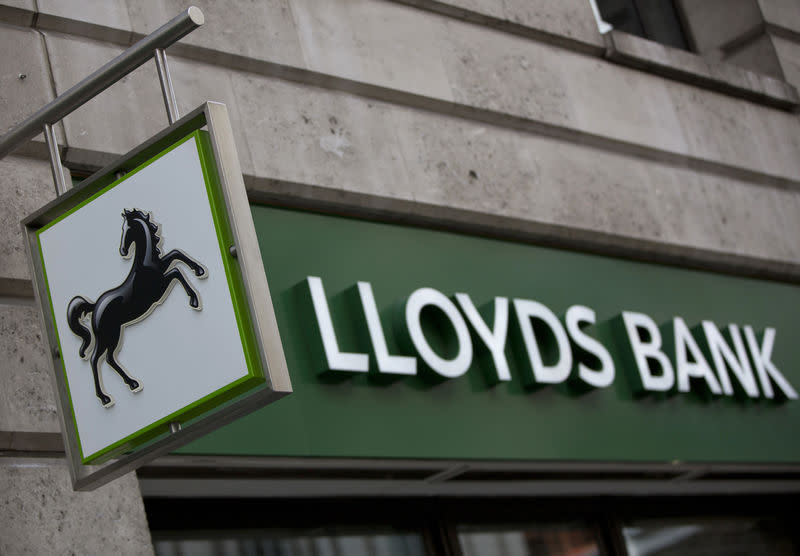 FILE PHOTO: A sign is seen outside a branch of Lloyds Bank in the City London February 3, 2014. EUTERS/Neil Hall