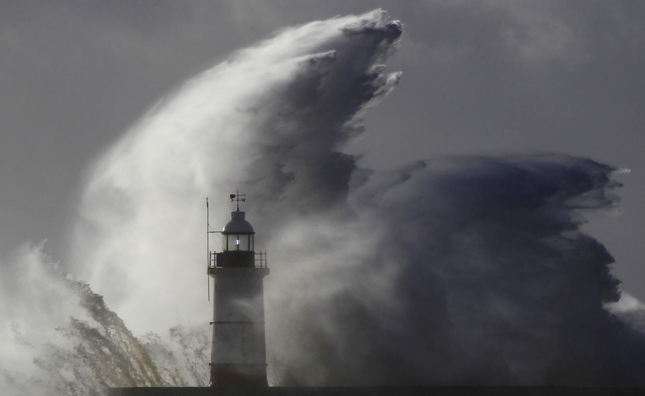 Waves crash against a lighthouse during storms that battered Britain and where a 14-year-old boy was swept away to sea at Newhaven in South East England October 28, 2013. Britain's strongest storm in a decade battered southern regions on Monday, forcing hundreds of flight cancellations, cutting power lines and disrupting the travel plans of millions of commuters. Police said rescuers were forced to call off a search for the boy late on Sunday due to the pounding waves, whipped up by the rising wind. REUTERS/Luke MacGregor (BRITAIN - Tags: ENVIRONMENT DISASTER)