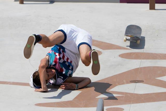 Jagger Eaton of the United States takes a tumble during the men's street skateboarding final in Tokyo