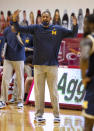 Michigan head coach Juwan Howard reacts to a call by the game officials during the first half of an NCAA college basketball game against Indiana, Saturday, Feb. 27, 2021, in Bloomington, Ind. (AP Photo/Doug McSchooler)
