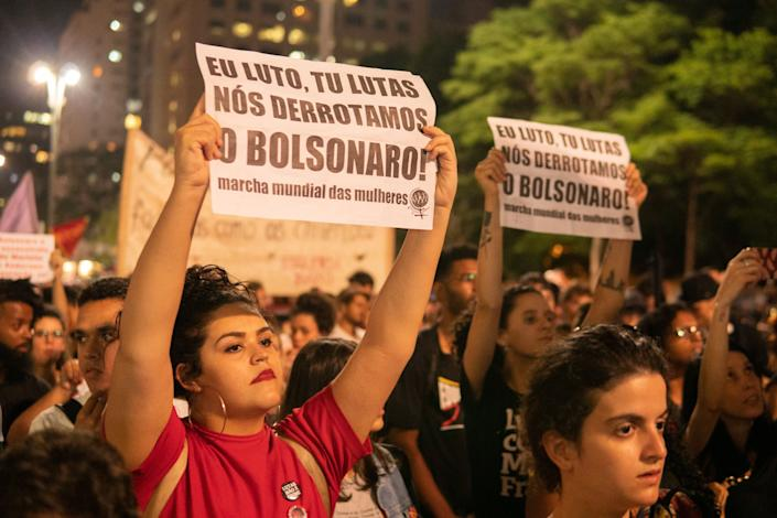A woman holds a paper during a protest in São Paulo, Brazil on October 31, 2019. (Photo: Felipe Beltrame/NurPhoto via Getty Images)