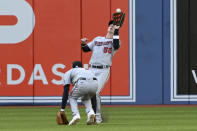 Minnesota Twins' Brent Rooker (50) catches a fly ball off the bat of Toronto Blue Jays' George Springer over a ducking Nick Gordon in the fifth inning of a baseball game in Toronto on Saturday, Sept. 18, 2021. (Jon Blacker/The Canadian Press via AP)
