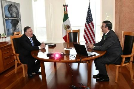 U.S Secretary of State Mike Pompeo speaks with Mexican Foreign Minister Marcelo Ebrard during a private meeting at the Foreign Ministry Building (SRE) in Mexico City