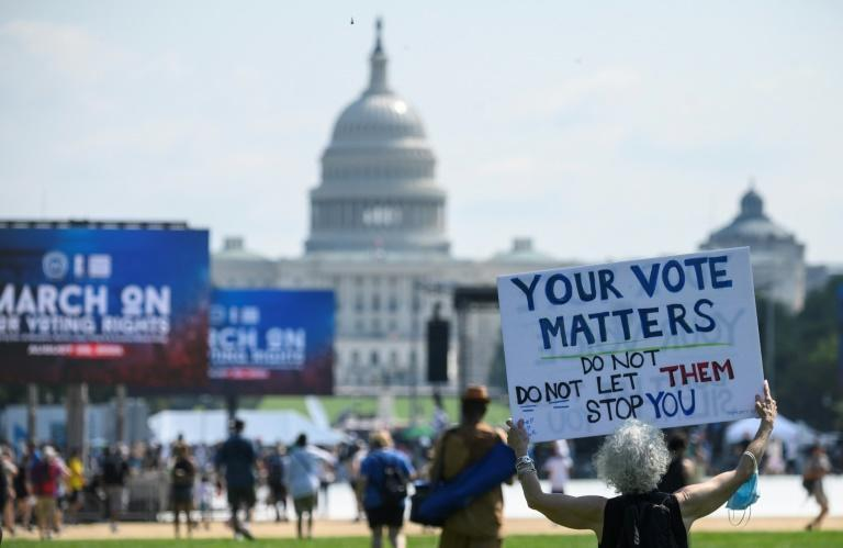 Protesters rally to demand protection for voting rights on the 58th anniversary of the 1963 March on Washington for Jobs and Freedom, in Washington, DC, on August 28, 2021 (AFP/Andrew CABALLERO-REYNOLDS)