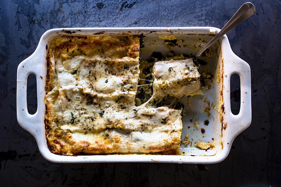 "A decent amount of béchamel keeps this tomato-less lasagna moist as it cools. <a href=""https://www.bonappetit.com/recipe/greens-cheese-lasagna?mbid=synd_yahoo_rss"" rel=""nofollow noopener"" target=""_blank"" data-ylk=""slk:See recipe."" class=""link rapid-noclick-resp"">See recipe.</a>"