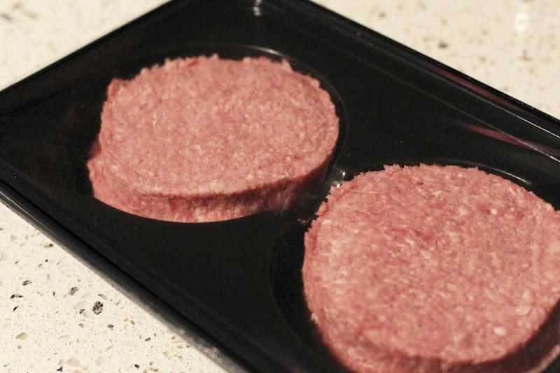 Photo made Jan 16 2013 of two beef burgers purchased in Ireland, following an outcry over the revelation that some burgers made in the republic and on sale in British supermarkets contained a large proportion of horse meat. The burgers were swiftly withdrawn from sale. A Spanish supermarket chain has withdrawn its own-brand hamburgers Wednesday Jan 30 2013 after a consumer protection group also found tiny traces of horsemeat in them.  (AP Photo/Niall Carson/PA) UNITED KINGDOM OUT  NO SALES  NO ARCHIVE