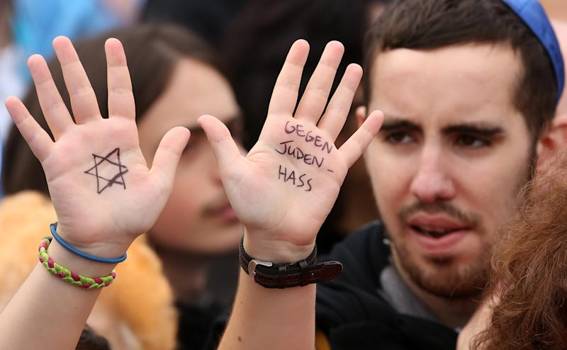 BERLIN, GERMANY - SEPTEMBER 14: A visitor with with a Star of David and the words 'Against Hatred Toward Jews' written on her hands attends a rally against anti-Semitism on September 14, 2014 in Berlin, Germany. With the slogan 'Stand Up! Never Again Hatred Towards Jews' ('Steh auf! Nie wieder Judenhass'), the Central Council of Jews in Germany (Zentralrat der Juden) organized the demonstration after anti-Semitic incidents in the country occurring in the wake of the conflict in Gaza this summer, in which more than 2,000 Palestinians were killed by the Israeli government, the majority of whom were civilians, according to Palestinian authorities. (Photo by Adam Berry/Getty Images)