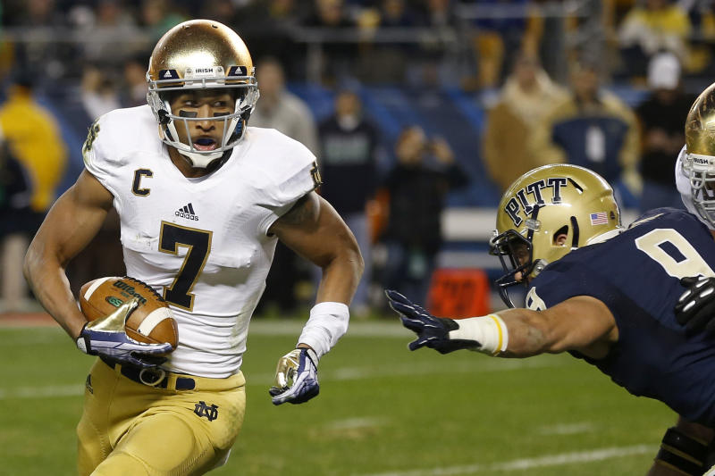 Notre Dame wide receiver TJ Jones (7) runs the ball past Pittsburgh defensive back Ray Vinopal (9) on his way to a touchdown in the second quarter of an NCAA college football game Saturday, Nov. 9, 2013, in Pittsburgh. (AP Photo/Keith Srakocic)