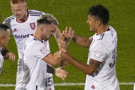 Real Salt Lake midfielder Albert Rusnak (11) is congratulated by teammate Marcelo Silva (30) after scoring a goal against the Colorado Rapids during the second half of an MLS soccer match Saturday, Aug. 21, 2021, in Commerce City, Colo. (AP Photo/ Jack Dempsey)