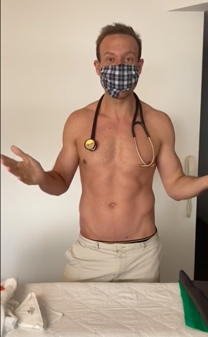 doctor wearing a face mask with his top off