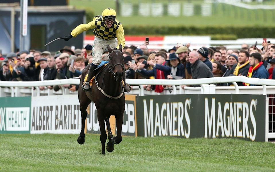 Jockey Paul Townend celebrates his victory in the Magners Cheltenham Gold Cup Chase on Al Boum Photo - PA