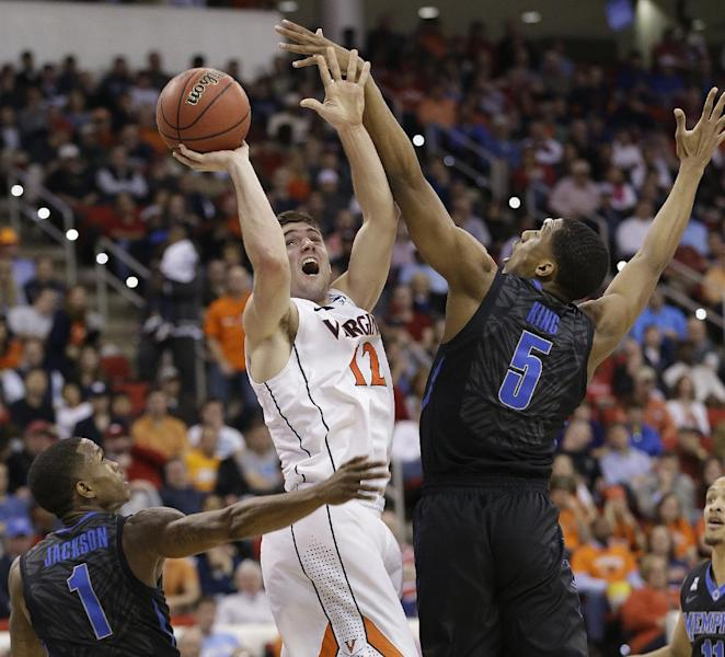 Virginia guard Joe Harris (12) shoots against Memphis' Nick King (5) and Joe Jackson (1) during the first half of an NCAA college basketball third-round tournament game, Sunday, March 23, 2014, in Raleigh. (AP Photo/Gerry Broome)