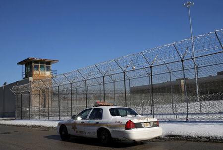FILE PHOTO: A Cook County Sheriff's police car patrols the exterior of the Cook County Jail in Chicago