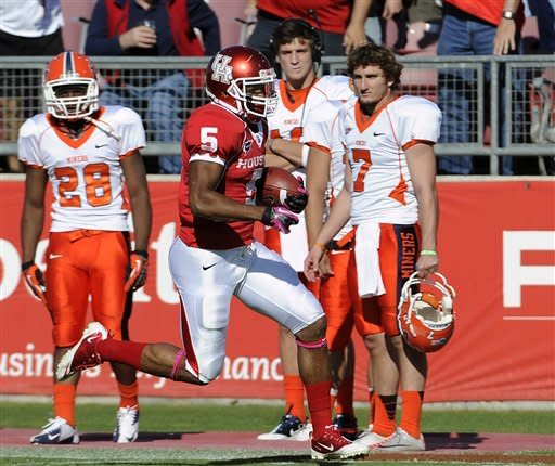 Houston running back Charles Sims (5) runs down the sideline in front of UTEP players for a touchdown during the first half of an NCAA college football game Saturday, Oct. 27, 2012, in Houston. (AP Photo/Pat Sullivan)