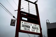 A sign at the 'George Floyd Square' memorial notes Day 21 of the Derek Chauvin murder trial