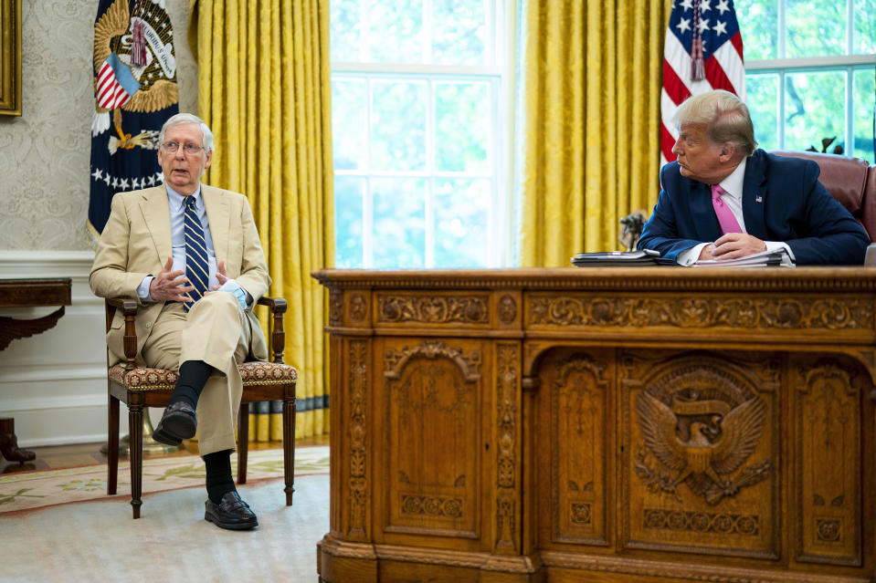 WASHINGTON, DC - JULY 20: Senate Majority Leader Mitch McConnell (R-KY) (L) listens to U.S. President Donald Trump talks to reporters while hosting Republican congressional leaders and members of Trump's cabinet in the Oval Office at the White House July 20, 2020 in Washington, DC. Trump and the congressional leaders talked about a proposed new round of financial stimulus to help the economy during the ongoing global coronavirus pandemic.  (Photo by Doug Mills-Pool/Getty Images)