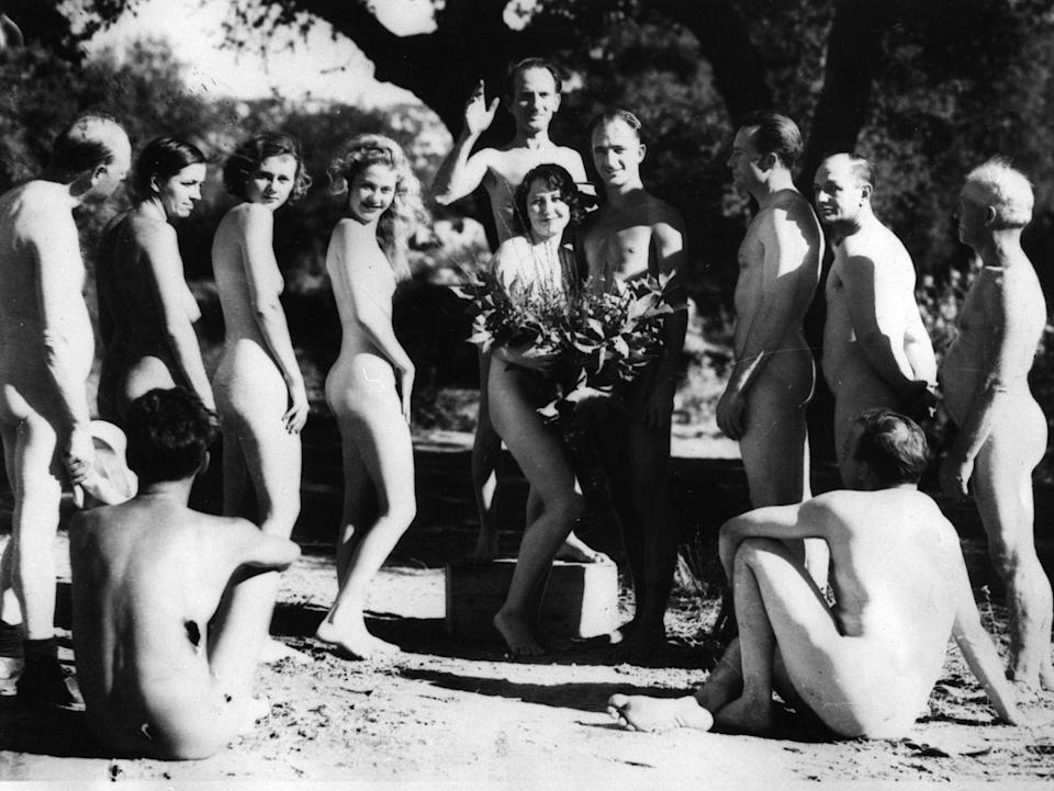 """<p>At this nudist colony wedding, the dress code was quite simple: Nothing at all, except for a few well-placed bouquets. That's one way to make things easier on guests. </p><p><a href=""""http://www.goodhousekeeping.com/beauty/fashion/g3617/most-scandalous-wedding-dresses/"""" rel=""""nofollow noopener"""" target=""""_blank"""" data-ylk=""""slk:10 wedding dresses that'll make you gasp »"""" class=""""link rapid-noclick-resp""""><em>10 wedding dresses that'll make you gasp »</em></a></p>"""