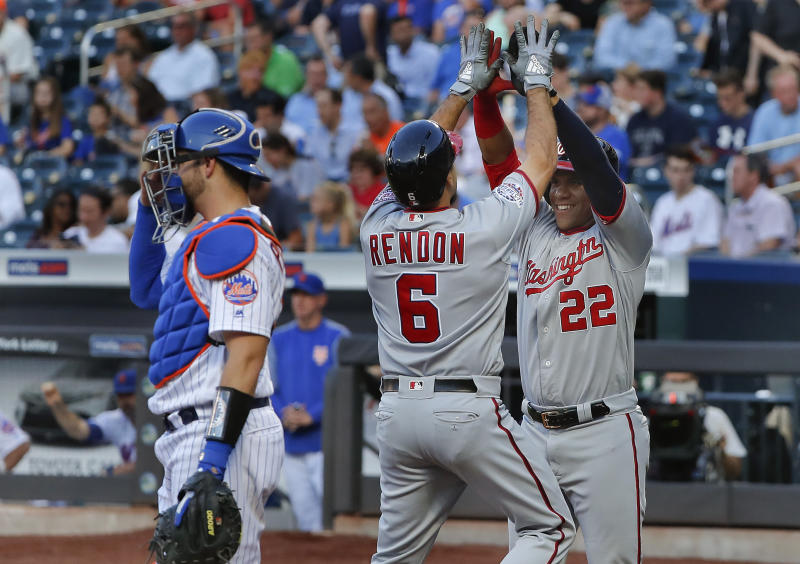 Washington Nationals' Anthony Rendon (6) is congratulated by Juan Soto after hitting a two-run home run against the New York Mets during the first inning of a baseball game Thursday, July 12, 2018, in New York.(AP Photo/Julie Jacobson)