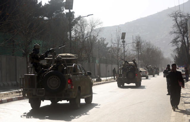 <p>Security forces are driven to the site of a deadly suicide attack in the center of Kabul, Afghanistan, Saturday, Jan. 27, 2018. (Photo: Massoud Hossaini/AP) </p>