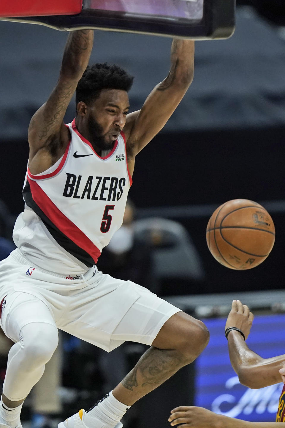 Portland Trail Blazers' Derrick Jones Jr. dunks during the second half of the team's NBA basketball game against the Cleveland Cavaliers, Wednesday, May 5, 2021, in Cleveland. (AP Photo/Tony Dejak)