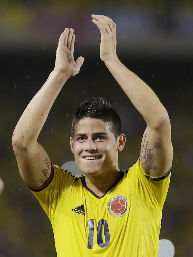 FILE - In this Sept. 6, 2013, file photo, Colombia's James Rodriguez celebrates after a 2014 World Cup qualifying match against Ecuador in Barranquilla, Colombia. Rodriguez is expected to take over the leadership of the Colombian Squad as it is still not sure if Radamel Falcao will play in the World cup due to injury. (AP Photo/Ricardo Mazalan, File)
