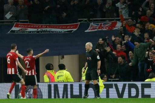 Buoyant Blades: George Baldock celebrates Sheffield United's equaliser at Tottenham