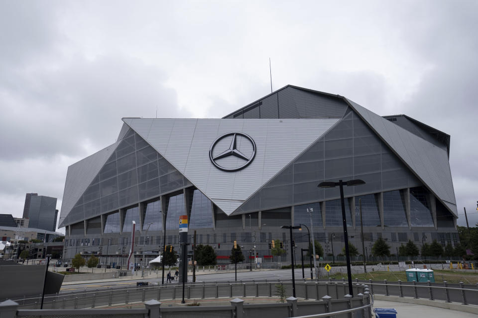 The exterior of the Mercedes-Benz Stadium in Atlanta is shown Friday afternoon, Sept. 17, 2021 in Atlanta. Officials were touring the stadium Friday as part of the FIFA World Cup 2026 Candidate Host City Tour. (AP Photo/Ben Gray)