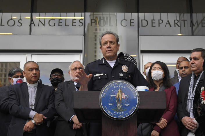"""FILE - In this June 5, 2020, file photo, Los Angeles police chief Michel Moore speaks during a vigil with members of professional associations and the interfaith community at Los Angeles Police Department headquarters in Los Angeles. The LAPD launched an internal investigation after an officer reported that a photo of George Floyd with the words """"You take my breath away"""" in a Valentine-like format was circulated among officers, according to a newspaper report. Moore said Saturday, Feb. 12, 2021, that investigators will try to determine how the image may have come into the workplace and who may have been involved, the Los Angeles Times reported. (AP Photo/Mark J. Terrill, File)"""
