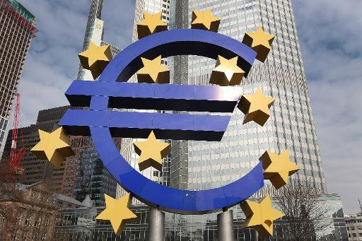 OECD trims growth forecasts and urges ECB to step up QE