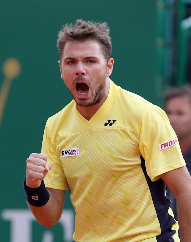 Stanislas Wawrinka of Switzerland celebrates after winning a point against David Ferrer of Spain, during their semifinal match of the Monte Carlo Tennis Masters tournament in Monaco, Saturday, April, 19, 2014. Wavrinka won 6-1, 7-6. (AP Photo/Claude Paris)