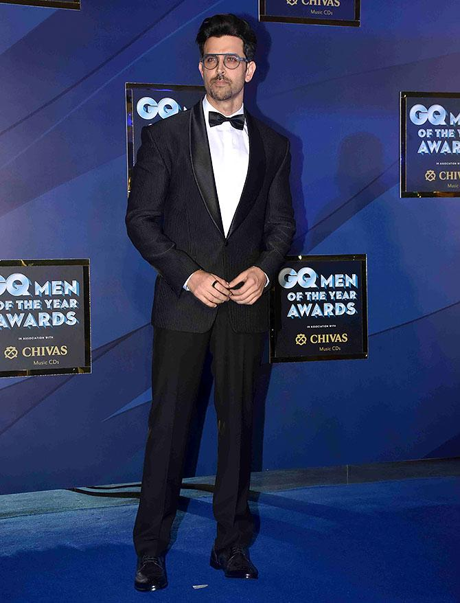The Greek God of Bollywood suited up for GQ Men of the Year Awards, in a black tuxedo, white dress shirt and a black bow tie. The actor shows how to elevate a classic look, with the help of pair of aviator-style glasses.