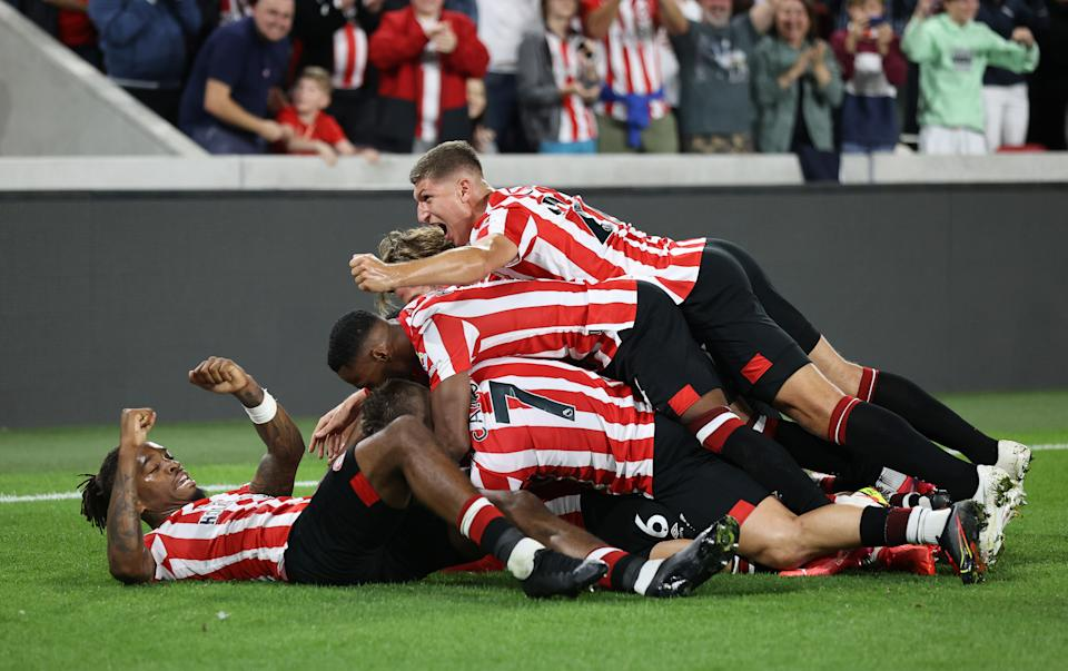 Pictured here, Brentford players celebrate during their season-opening win against Arsenal.