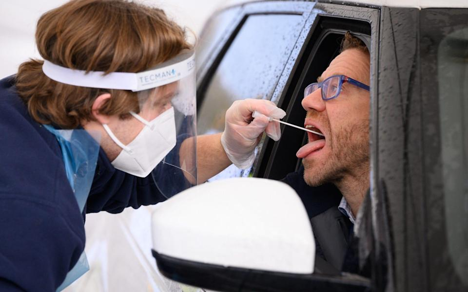 Nick Markham, the founder of ExpressTest, reacts as he takes a PCR swab test at Gatwick Airport - Leon Neal/Getty Images
