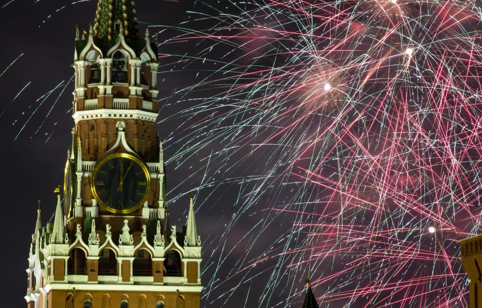 Fireworks explode over the Kremlin during New Year's celebrations in Red Square with the Spasskaya Tower in Moscow, Russia, Wednesday, Jan. 1, 2020. Russians began the world's longest continuous New Year's Eve with fireworks and a message from President Vladimir Putin urging them to work together in the coming year. (AP Photo/Denis Tyrin)