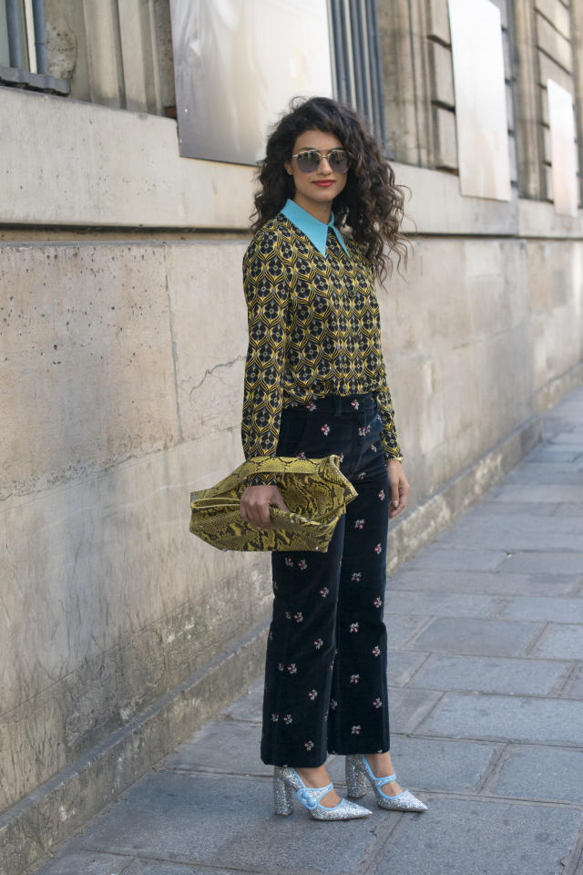 <p>As if her patterned Miu Miu top, Maison Margiela pants, snakeskin Jil Sander bag and Dior sunglasses wasn't enough to excite, Tiari completed her loud look with our favorite sparkly Miu Miu pumps. (Getty Images)</p>
