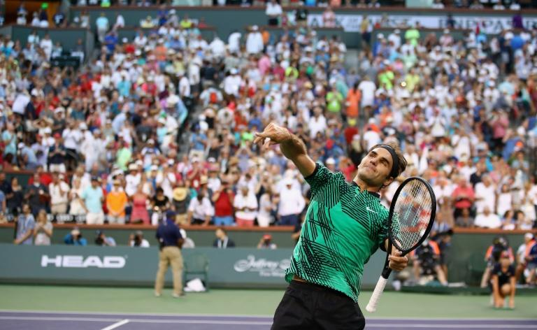 Roger Federer celebrates his straight sets win over Rafael Nadal in their fourth round match at Indian Wells