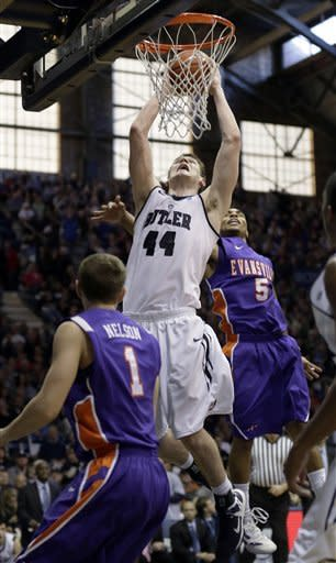 Butler center Andrew Smith (44) shooots between Evansville defenders Jordan Nelson (1) and Troy Taylor (5) during the second half of an NCAA college basketball game, Saturday, Dec. 22, 2012, in Indianapolis. Butler won 75-67. (AP Photo/AJ Mast)