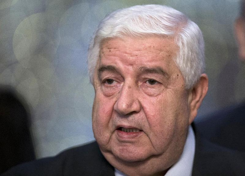 """Syrian Foreign Minister Walid al-Moallem speaks to the media in Moscow, Monday, Sept. 9, 2013. Syria's foreign minister said his country welcomes Russia's proposal for it to place its chemical weapons under international control and then dismantle them quickly to avert U.S. strikes. Moallem's statement came hours after U.S. Secretary of State John Kerry said Assad could resolve the crisis surrounding the alleged use of chemical weapons by his forces by surrendering control of """"every single bit"""" of his arsenal to the international community by the end of the week. (AP Photo/Alexander Zemlianichenko)"""