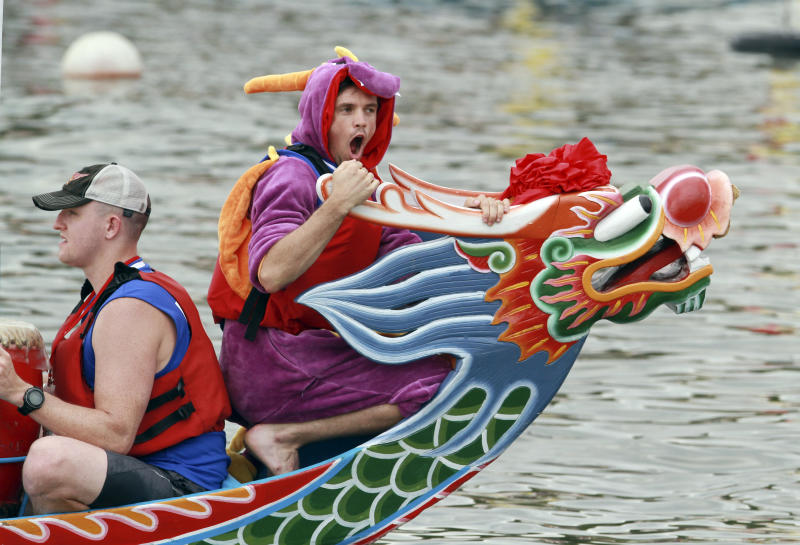 <p>A boat captain wears a dragon costume during a traditional Chinese Dragon Boat race in Taipei, Taiwan, Saturday, June 20, 2015. Dragon boat races are in remembrance of Chu Yuan, an ancient Chinese scholar-statesman, who drowned in 277 B.C. while denouncing government corruption. (AP Photo/Chiang Ying-ying)</p>