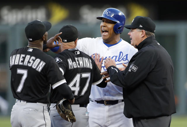 Chicago White Sox bench coach Joe McEwing separates shortstop Tim Andersonfrom Kansas City Royals' Salvador Perez at second base after an exchange of words causing the benches to clear. (AP Photo)