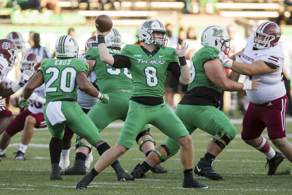 Marshall quarterback Grant Wells (8) looks to make a throw against Massachusetts during an NCAA college football game Saturday, Nov. 7, 2020, in Huntington, W.Va. (Sholten Singer/The Herald-Dispatch via AP)