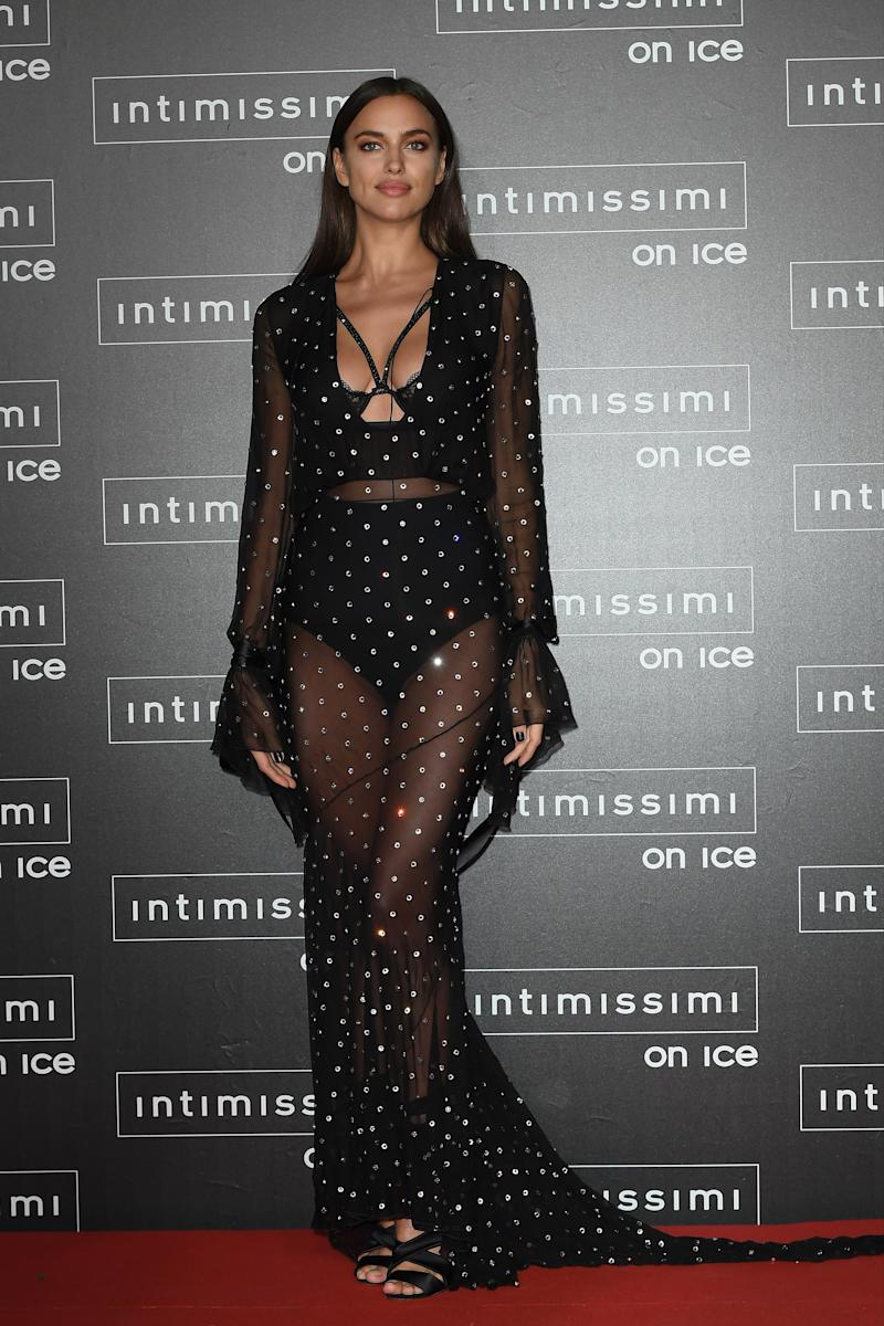 Just before pregnancy rumors began to swirl, Shayk showed off her body in a sheer black and gold gown.