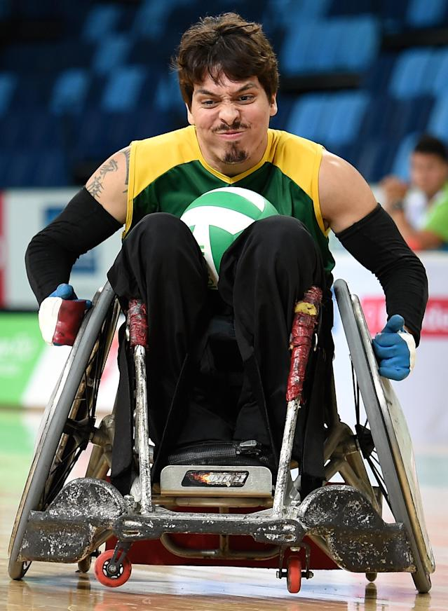 RIO DE JANEIRO, BRAZIL - FEBRUARY 26: Guilherme Figueiredo Camargo of Brazil scores a try during the International Wheelchair Rugby Championship - Aquece Rio Test Event for the Rio 2016 Paralympics match between Brazil and Canada at Olympic Park on February 26, 2016 in Rio de Janeiro, Brazil. (Photo by Buda Mendes/Getty Images)