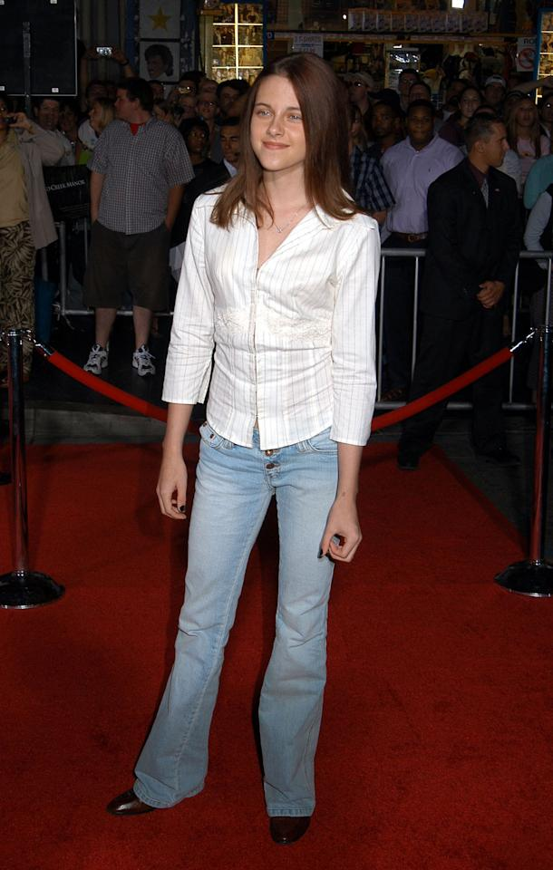 <p>Kristen Stewart in relaxed boot cut jeans with a simple oxford to a premiere in 2003. (Photo: Getty Images) </p>