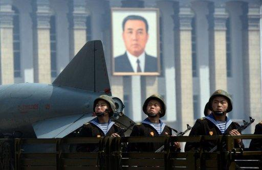North Korean military ride on the back of a truck during a parade to mark 100 years since the birth of the country's founder Kim Il-Sung, in Pyongyang, in April